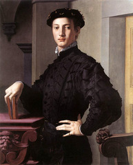 41. Bronzino, Portrait of a Young Man, 1530, CE, Metropolitan Museum of Art, New York, oil on wood. Bronzino's figures usually have the same facial features, both male and female. The artwork is influenced by Pontormo's Guard. The subject is most likely a proud intellectual patrician with his haughty posture, graceful long fingers, book, and severe architecture. The influence of Spanish etiquettes is seen through the man's doublet and cap. Bronzino purposefully sets the color scheme as muted to emphasize the subject's meticulously architecture silhouette. The subject is probably one of Bronzino's literary friends. Bronzino adds a theme of identity through the grotesque heads on the furniture and masklike faces in the folds of his breeches.
