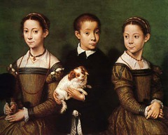 46. Sofonisba Anguissola, Portrait of the Artist's Sisters and Brother, 1555, CE, Methuen Collection, Corsham Court, Wiltshire, oil on panel. This family portrait is unrealistically staged with much emphasis on the simple expressions and relaxed poses of the artist's siblings. This is a contrast to Mannerism's exemplary idealism and exaggeration. However, the slight unbalanced symmetry, leaning towards the right, is typical of Mannerist paintings. Affectionately, for the brother holds a dog while the younger sister (right) diverts her attention to her right. The older sister shows dignity that matches the scene's formality. Anguissola is one of the few female Mannerist painters, and she was influenced by Michelangelo.