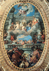 54. Paolo Veronese, Triumph of Venice, 1585, CE, ceiling of the Hall of the Grand Council, Palazzo Ducale, Venice, Italy, oil on canvas. This painting is an allegory for the fight for peace and justice in Venice, represented by Mary. It represents Venice's triumph over the Pope and other Italian city-states. Mary is crowned by Victory as she is taken up to heaven on a cloud. The Rape of Europa is at the bottom of the painting, and represents Europe's art heritage and the struggle for artistic freedom. The rest of the painting depicts the different areas of Venetian society. Veronese often painted Venetian skies, animals, and historical stories. In 1508, Pope Julius II tried to limit the influence Venice and Doge Leonardo Loredan had over other Italian city-states. He was afraid that if Venice's power was not curbed, the Papal states would turn away from the Pope and God. Julius II made an alliance with Spain, France, and the Holy Roman Empire called the League of Cambrai. This led to early Venetian losses, including the loss of Padua. Eventually, France broke with the Pope and allied with Venice and defeated the League. This ended with the Pope repaying his debts to Venice and the regaining of Padua. The victory led to the popularity of Venetian artwork, as people expressed their love for the state through art.