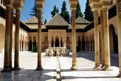 Alhambra Granada, Spain. Nasrid Dynasty. 1354-1391 C.E. Whitewashed adobe stucco, wood, tile, paint, and gilding The Alhambra's architecture shares many characteristics, but is singular in the way it complicates the relationship between interior and exterior. Its buildings feature shaded patios and covered walkways that pass from well-lit interior spaces onto shaded courtyards and sun-filled gardens all enlivened by the reflection of water and intricately carved stucco decoration.