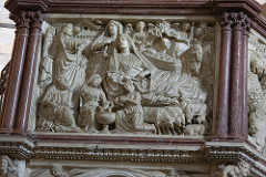 Annunciation & Nativity by Nicola Pisano, Proto-Renaissance - framed in arches, part of Pulpit of Pisa - Inspiration Classical sarcophagus, no spacial recession, few shadows - Gestures: 2 figures in corner, 2 angels pointing at Mary, pointing to herself in disbelief, no body contour, little recession into space - Posture: Like sarophagus, like lounging, but tilted on one hip, very unnatural pose  - Faces are types, except for facial hair, heavy draperyand figures, sustematic folds -Third bottom sceene, women washing, farm animals, people coming to see christ, nativity scene Nativity and Annunication to the