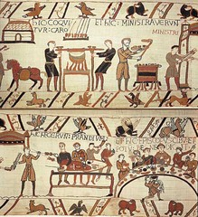 Bayeux Tapestry Romanesque Europe. c. 1066-1080 C.E. Embroidery on linen The Bayeux Tapestry has been much used as a source for illustrations of daily life in early medieval Europe. It depicts a total of 1515 different objects, animals and persons . Dress, arms, ships, towers, cities, halls, churches, horse trappings, regal insignia, ploughs, harrows, tableware, possible armorial changes, banners, hunting horns, axes, adzes, barrels, carts, wagons, reliquaries, biers, spits and spades are among the many items depicted