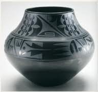 Black-on-black ceramic vessel Maria Martinez and Julian Martinez, Tewa, Puebloan, San Ildefonso Pueblo, New Mexico. c. mid-20th century C.E. Blackware ceramic They discovered that smothering the fire with powdered manure removed the oxygen while retaining the heat and resulted in a pot that was blackened. This resulted in a pot that was less hard and not entirely watertight, which worked for the new market that prized decorative use over utilitarian value. The areas that were burnished had a shiny black surface and the areas painted with guaco were matte designs based on natural phenomenon, such as rain clouds, bird feathers, rows of planted corn, and the flow of rivers.