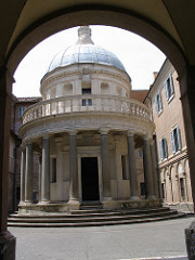 Bramante. Italian. Tempietto (at San Pietro in Montorio, Rome), 1502 High Renaissance -based on humanistic values on reviving the ancient Roman models, the building received its name because it appears to look like a little ancient temple -the round temples of ancient Rome directly inspired his design -Patrons: King Ferdinand and Queen Isabella of Spain -plan circular STYLOBATE (stepped temple platform) and an austere Tuscan style colonnade -Bramante achieved a wonderful balance and harmony in the relationship of the dome, drum and base, very unique, although resembles the Greek Tholos, it is different with the combination and new, (Classical Tholoi did not have a drum nor balustrade