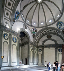 Brunelleschi, Pazzi Chapel, 1420-1460,  -Brunelleschi wanted to return to the classical tradition of Ancient Rome by creating a centrally planned space with barrel vaulting, pendentives, and a hemispherical dome with an oculus to let light in. He also focused on the geometric elements of Ancient Roman art as many rectangular and circular structures are included. He uses Pietra serena,a grayish green tone to emphasize the decorative narratives on the walls. This return to classicism is influential in High Renaissance art, but was very unusual for the time period.The Pazzi chapel was a chapter house, so local monks met there.