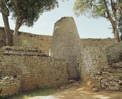 Conical tower and circular wall of Great Zimbabwe Southeastern Zimbabwe, Shona peoples. c. 1000-1400 C.E. Coursed granite blocks In some places, the walls are several meters thick, and many of the massive walls, stone monoliths and conical towers are decorated with designs or motifs. Patterns are worked into the walls, such as herringbone and dentelle designs, vertical grooves, and an elaborate chevron design decorates the largest building called the Great Enclosure