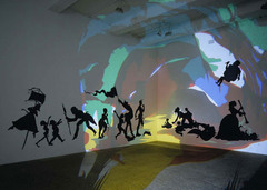 Darkytown Rebellion Kara Walker. 2001 C.E. Cut paper and projection on wall. Black silhouettes against colorful background, sharp lines, distinct and defined shapes. The actual subject of the work is meant to reflect the antebellum South during the time of slavery. Many southern African-American stereotypes are still present today and Walker hoped to make viewers realize how subconsciously they had these premeditated ideas about the figures and the assumptions about race they automatically made because of popular culture.