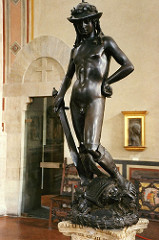 David by Donatello, 15th Cen. Italian Ren - Bronze, commissioned by Medicis for palace  - freestanding nude statue since classical era  - forgetting some of realism, but more of symbol of florentine love of liberty - medici responsibility for freedom and prosperity, more political than biblical  - opposing axes of intense and relaxed  - 15th cen boots and hat, like god Mercury  - hand on hip - very self-contented ooh - s-curve weight shift  - high patina - goliath = milan