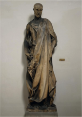 Donatello, Italian. Zuccone, 1423—25 Early Renaissance. Lo Zuccone (Italian: literally, pumpkin; figuratively bald-head) is a marble statue by Donatello. It was commissioned for the bell tower of the Florence Cathedral of Florence, Italy and completed between 1423 and 1425. It is also known as the Statue of the Prophet Habakkuk, as many believe it depicts the Biblical figure Habakkuk. The statue is known for its realism and naturalism, which differed from most statuary commissioned at the time. In recent times it is gaining renewed popularity from its uncanny resemblance to 'Harry Potter' villain Lord Voldemort. Zuccone is reported to have been Donatello's favorite, and he was said to swear by the sculpture,
