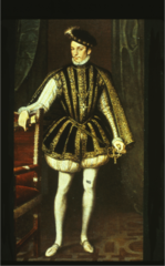 Elizabethan. Full-skirted jerkin over a cream doublet. Padded pumpkin hose, slashed shoes, hanging sleeves. His jerkin may be peascodded. The shoes are wide and slashed. Note the small ruff. His costume is a blend of English and Italian.