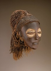 Female (Pwo) mask Chokwe peoples (Democratic Republic of the Congo). Late 19th to early 20th century C.E. Wood, fiber, pigment, and metal Chokwe masks are often performed at the celebrations that mark the completion of initiation into adulthood. That occasion also marks the dissolution of the bonds of intimacy between mothers and their sons. The pride and sorrow that event represents for Chokwe women is alluded to by the tear motif.