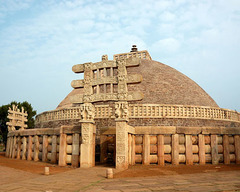 Great Stupa at Sanchi Madhya Pradesh, India. Buddhist; Maurya, late Sunga Dynasty. c. 300 B.C.E. - 100 B.C.E. Stone masonry, sandstone on dome It was probably begun by the Mauryan emperor Ashoka in the mid-3rd century bce and later enlarged. Solid throughout, it is enclosed by a massive stone railing pierced by four gateways, which are adorned with elaborate carvings (known as Sanchi sculpture) depicting the life of the Buddha.