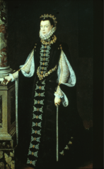 High contrast in black and white with heavy use of trim. hanging sleeves. outer sleeves have brooch. Ruff, pointed waistline and small headdress.