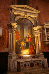 Madonna of the Pesaro Familiy by Titian, Venetian - Canvas inside architectural arch  - Bishop Pisaro, papal fleet  - successful expedition during venetian- turkish war - Madonna receiving commander, who is kneeling, soldier behind = st george?  - borgia pope line - individual w/turban - turkish hostage, success of venice  - st peter recording on book  - st francis present, presenting rest of pissaro family members - everything diagonally-based, madonna out of center, focus on pisarro  - banner gives other diagonal, balanced - courtly splendor - monumental figures - single or in groups, majesty of event itself