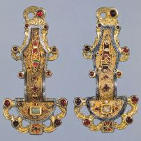 Merovingian looped fibulae Early medieval Europe. Mid-sixth century C.E. Silver gilt worked in filigree, with inlays of garnets and other stones. It is normal for similar groups to have similar artistic styles, and for more diverse groups to have less in common. Fibulae is proof of the diverse and distinct cultures living within larger empires and kingdoms, a social situation that was common during the middle ages.