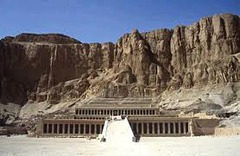 Mortuary Temple of Hatshepsut Near Luxor, Egypt. New Kingdom, 18th Dynasty. c. 1473-1458 B.C.E. Sandstone, partially carved into a rock cliff, and red granite. It sits directly against the rock which forms a natural amphitheater around it so that the temple itself seems to grow from the living rock. Most beautiful of all of the temples of Ancient Egypt.