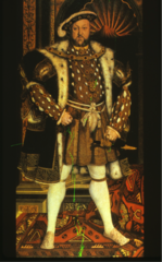 Northern Renaissance. Slashing on the sleeves with attached hanging sleeves. Shirt has a turned-down collar. Codpiece, Netherstocks (lower stockings), Order of the Garter around his leg, Doublet, jerkin, overgown and flat cap. Henry also wears an Order.