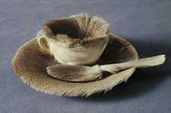 Object (Le Déjeuner en fourrure). Meret Oppenheim. 1936 C.E. Fur-covered cup, saucer, spoon In doing so, she said she wanted to transform items typically associated with feminine decorum into sensuous tableware. It also provoked the viewer into imagining what it would be like to drink out of a fur-lined cup.