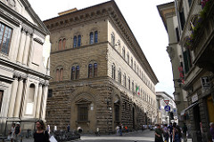 Palazzo Medici-Riccardi by Bartolomeo, 15th Cen. Italian Ren. - boom of palace-building - heavy cornice line, solid and fortress-like - focus on 3 registers on facade, descending height - rough stone on bottom, clear-cut near top  - arches relief around windows  - built around open-colonnaded courtyard