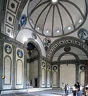 Pazzi Chapel by Brunelleschi, 15th Cen. Italian Ren - plan done mathematically  - circle in center, semicircular sides - square/rectangular bases - white w/ornamentation pietra serena on inside - balance and symmetry w/geometry - dual archways opposite each other, with 2 barrel vaults, typanum matching archways - power to withold walls  - medalions match in parallels, englazed terracotta relief - 12 apostles in panels  - dome 4 evangelists, ribbing