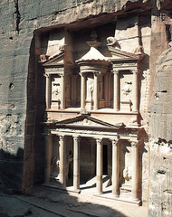 Petra, Jordan: Treasury and Great Temple Nabateen Ptolemaic and Roman. c. 400 B.C.E - 100 C.E. Cut rock These elaborate carvings are merely a prelude to one's arrival into the heart of Petra, where the Treasury, or Khazneh, a monumental tomb, awaits to impress even the most jaded visitors. The natural, rich hues of Arabian light hit the remarkable façade, giving the Treasury its famed rose-red color.