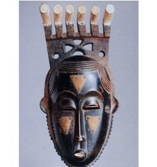 Portrait mask (Mblo) Baule peoples ( Côte d'Ivoire). Early 20th century C.E. Wood and pigment The mask is exceptional for its nuanced individuality, highly refined details, powerful presence, and considerable age. It is especially appealing for its unusual depth that affords strong three-quarter views. The broad forehead and downcast eyes are classic features associated with intellect and respect in Baule aesthetics. The departure from a rigidly symmetrical representation suggests an individual physiognomy. The expression is one of intense introspection. Its serenity is subtly animated by two opposing formal elements: the flourishes of the coiffure and beard at the summit and base.