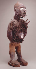 Power figure (Nkisi n'kondi) Kongo people's (Democratic Republic of Congo). c. late 19th century C.E. Wood and metal Nkisi nkondi figures are highly recognizable through an accumulation pegs, blades, nails or other sharp objects inserted into its surface.