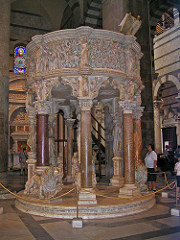 Pulpit of Pisa Cathedral by Nicola Pisano, Proto-Renaissance -15', more architecutal work, sculpture on inside - Nicola Pisano exposed to pulpits, marble reliefs, so piece was open pulpit hah - Medieval tradition/techniques: trilobed arches like in Doge's Palace, lions supporting columns - Classical tradition/techs: large bushy capitals, rounded not pointed arches, large rectangular relief panels, like roman sarcophagi