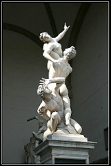 Rape (Abduction) of Sabine Women by Bologna, Mannerism - sculptural, marble, 13' - intertwined figures, release of emotion, sculpted in true anatomy - alludes to mythological, but very realistic - on central axis - spins around one point  - cylindrical space - negative space important as solid mass  - 1st large scale since classical era
