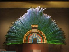 Ruler's feather headdress (probably of Motecuhzoma II) Mexica (Aztec). 1428-1520 C.E. Feathers (quetzal and cotinga) and gold He headdress was probably part of the collection of artefacts given by Motecuhzoma to Cortés who passed on the gifts to Charles V. The headdress is made from 450 green quetzal, blue cotinga and pink flamingo feathers and is further embellished with gold beads and jade disks.
