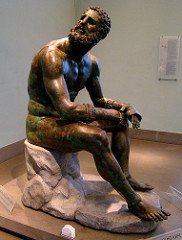 Seated boxer Hellenistic Greek. c. 100 B.C.E. Bronze The sculpure shows both body and visage to convey personality and emotion. It shows transformation of pain into bronze, a parallel of recent photos of our contemporary Olympic athletes after their strenuous competitions.