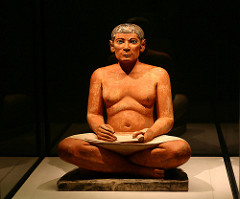 Seated Scribe Saqqara, Egypt. Old Kingdom, Fourth Dynastic. c. 2620-2500 B.C.E. Painted limestone. the sculpture of the seated scribe is one of them most important examples of ancient Egyptian art because it was one of the rare examples of Egyptian naturalism, as most Egyptian art is highly idealized and very rigid.