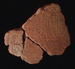 Terra Cotta Fragment Lapita. Solomon Islands, Reef Islands. 1000 B.C.E. Terra cotta (incised) One of the first examples of the Lapita potter's art, this fragment depicts a human face incorporated into the intricate geometric designs characteristics of the Lapita ceramic tradition.
