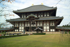 Todai-ji Nara, Japan. Various artist, including sculptors Unkei and Keikei, as well as the Kei School. 743 C.E.; rebuilt c. 1700. Bronze and wood (sculpture); wood with ceramic-tile roofing (architecture) Todaiji represented the culmination of imperial Buddhist architecture. Todaiji is famous for housing Japan's largest Buddha statue. It housed the largest wooden building the world has yet seen. Even the 2/3 scale reconstruction, finished in the 17th century, it remains the largest wooden building on earth today.