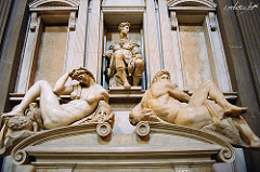 Tomb of Giuliano de'Medici by Michaelangelo, High Ren - 1519-34, marble - twin to brother Juiliano's tomb - very philosophical - would've been pair of river gods underneath to create stability - ascent of person's soul through levels of neoplatonic universe  - underworld = brute matter, source of evil  - 2 statues on sarcophagus = plane and movement of time, humanity's state in existence is one of pain, anxiety, frustration, exhaustion - left: female night, right: male day - never relaxed, very much in tension, reminiscent of bound slaves - tense contrapposto - day: thickness of tree, anatomy of hercules, straining huge limbs, over shoulder = unfinished face, trapped in world of time - night: supposed time of rest, instead twisting as if trouble sleeping, wrenched position, surrounded by owl, poppy flowers, hideous mask - nighmares - medici sits over troubles of time - ideal human type of active man, done work, now promoted in death - lorenzo = active thinker, guiliano = active military man  - ideals based on christ - double plaster, typanums, volutes, garlens above typical roman