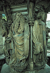 Well of Moses by Sluter, 15th Cen. Northern Ren  - super philosophical, 1395 limestone w/ some paint traces, 6' tall figures  - In charge of Philip Bold's workshop  - Sculptural fountain in well giving water for whole monastary  - Carthusian belief/commitment to silence and prayer, no sound allowed - surrounding base: moses, david, other prophets, supported group of crucifixion above (pedastle)  - fountain of life, blood of christ from above flows down crucifixion, wash away sins of those below, promises of everlasting life - each recall jamb statues, but more realistic renderings, details  -deep undercut drapery, foldings,